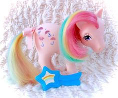 A wonderful G1 My Little Pony Parasol rainbow pony in good vintage condition with her original (and very hard to find) rainbow star hair brush! Some minor marks/flaws present, and a slight hair trim and hair is a tad dry. Comes with hair bow!  Please see all pictures up close for a thorough representation of the item! I have TONS more cute vintage items for sale in my Etsy shop - check it out for SUPER CHEAP combined shipping discounts. ;) I ship WORLDWIDE from a clean, pet & smoke-free…