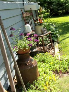 Add some old garden and farm tools, chairs, and milk cans to the garden for decor.
