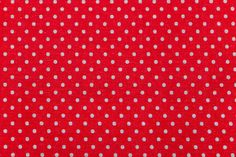 red fabric with white polka dots