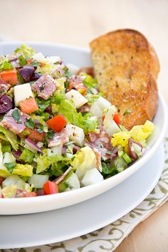 Italian Chopped Salad with Fresh Mozzarella and Salami In Herbed Red Wine Vinaigrette with Garlic Toast Wedge