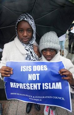 Zainab Oye 12 & aisha Oye 9 both from Clonsilla during a Not in Our Name protest against Islamic State (IS) on O' Connell Street, Dublin. Photo: Gareth Chaney Collins