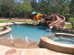 Beach Entry Pool With Rock Water Features by bettye