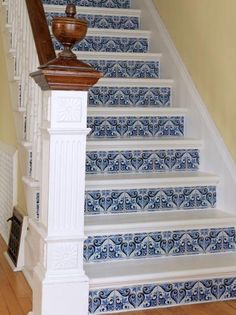 DIY Network has instructions on how to paint a staircase and use wallpaper on the risers.