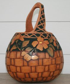 Debra Maerz shares her Gourd Basket which was cut, wood burned and painted with acrylics.