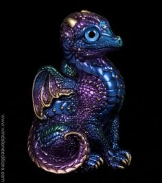 Baby Dragon - Peacock - He is trying to look just as regal as the older members of his dragon family, but still has some growing to do.This one is painted to match the old retired Peacock dragon family. $68.00
