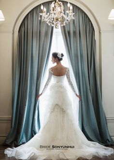 Royal wedding dress with long sleeves with lace appliqués.  Layered skirt back with beads and lace appliqués. Imperial style wedding dress #웨딩드레스 #WEDDING #손윤희드레스 #신상드레스 #웨딩드레스화보 #드레스대여 #웨딩화보  #브라이드손윤희