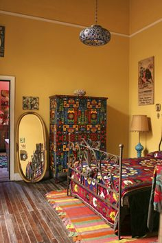 I like the mix of textiles and the painted armoire