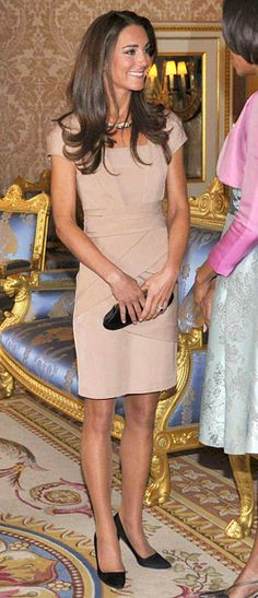 80 of 89 May 24, 2011 It was a meeting of the sartorial minds when Kate Middleton met Michelle Obama. Fresh from her mini-honeymoon, a freshly-tanned Middleton wore a camel-hued cap-sleeve bandage dress by Reiss.