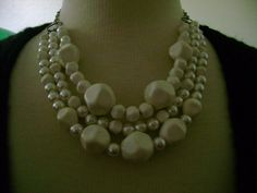 A personal favorite from my Etsy shop https://www.etsy.com/listing/89223445/faux-pearl-and-vintage-bead-necklace-one