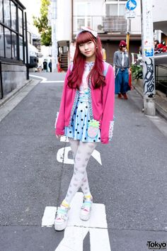 Niha is an 18-year-old student with pink hair who we met in Harajuku. Her look includes a lace-decorated sweater from the Harajuku resale shop Panama Boy, a skirt and candy tights from #Spank! #girls, WEGO platform sandals, and a #The #Little #Mermaid backpack. #tokyofashion #street snap #Harajuku