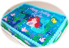 Little Mermaid - Butter cream sheet cake.  Ariel, Flounder and rocks in fondant.  Plants, coral etc. in butter cream.