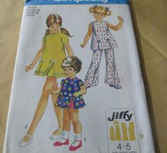 1970  Simplicity Pattern # 8717 Child 's And Girls' Jiffy Play Dress Shorts And Bell Bottom Pants Size 4 Breast 23 Waist 21 Uncut by GwensHaberdashery on Etsy