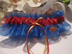 Superman Wedding Garter via Etsy fantastic. I could picture Henry Cavill taking this off me leg at our wedding lol!!!!!
