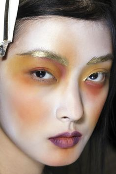 facesauce:  Vivienne Westwood makeup by Val Garland for MAC - gold brows - orange & plum accents