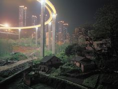 The Caiyuanba Bridge, completed in 2007, contrasts with the more rural outskirts of Chongqing, China