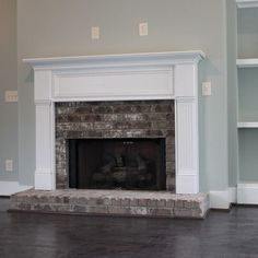 This is similar to cabinets - replace the brick with tile and the side trim to match the center trim
