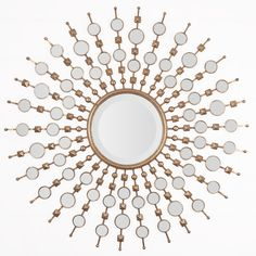 Metal Sunburst mirror finished in Gold Leaf and surrounded by Decorative mirrored Accents