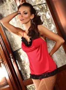 Soft red chemise with a subtle sheen. The upper and lower part of the back are trimed with black lace. Giovanna has a halter neck tie with an unusual design at the rear. Scooped neckline adding a touch of elegance. Matching thong is included.