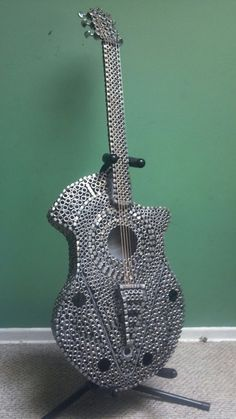 Industrial Guitar sculpture recycled stainless steel nuts full sized. $3,500.00…