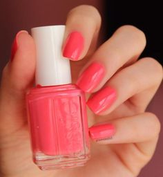 Bright coral nail polish is perfect for spring with essie 'cute as a button'.