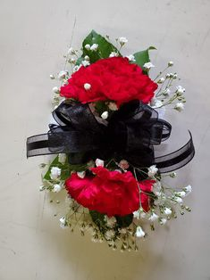 Red Carnations, baby's breath, and greens on a wristlet with a black bow. Red Carnation, Baby's Breath, Corsages, Boutonnieres, Carnations, Bows, Black, Decor, Decoration