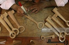 Palestinian wood carver Nasser Flefel, 37, decorates wooden keys symbolising the houses that Palestinians had to flee in 1948, at his shop in Gaza City on May 10, 2008. About 760,000 Arabs lost their homes in the war that started immediately after Israel declared its independence in May 1948. The fate of the estimated 4.5 million refugees and their descendants is one of the thorniest issues of the Israeli-Palestinian conflict. Israel opposes any suggestion that the refugees be allowed to…