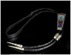 Carl & Irene Clark (Navajo), Yei Bolo Tie (Silver),  3 x 1 3/8 x inches, Sterling silver, coral, turquoise, surgilite, mother of pearl, and lapis. At the Gerald Peters Gallery, Santa Fe, NM.
