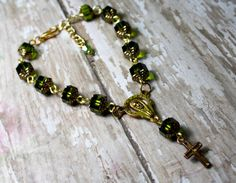 Hey, I found this really awesome Etsy listing at https://www.etsy.com/listing/481083303/green-rosary-bracelet-pocket-rosary