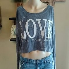 Love crop top Love long sleeve crop top. Has love in three other languages. 50% cotton 50% polyester. L.O.L. Vintage Tops Crop Tops