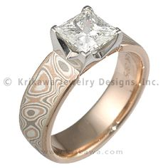 Two Tone Mokume Princess Solitaire Engagement Ring - Taking the Modern feel a little farther with the clean lines of a princess cut diamond, this unique engagement ring has a straight band with a slightly tapered square setting. The setting has 4 cutouts. This engagement ring will fit next to a straight wedding band. Main image shown is 6mm wide.   - This unique engagement ring has a two tone mounting. A tricolor mokume gane, Champagne, is inlaid in a rose gold band.