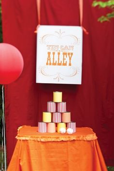 Set up this carnival game booth by upcycling aluminum cans and wrapping them in scrapbook paper. - ideas for our next carnival Circus Carnival Party, Kids Carnival, Spring Carnival, School Carnival, Carnival Wedding, Carnival Birthday Parties, Halloween Carnival, Carnival Themes, Circus Birthday