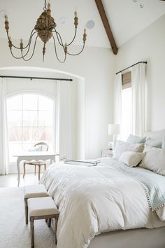French country bedroom with Alabaster (Sherwin Williams) pain on walls. Discover inspiring understated neutrals to try in your own home. #paintcolors #sherwinwilliamsalabaster #whitepaintcolors #bestwhitepaint