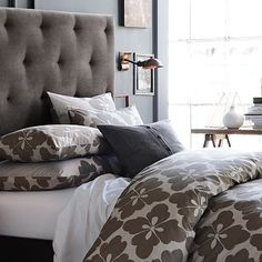 deciding whether or not to get those fancy iron headboards or something soft like this... hm...