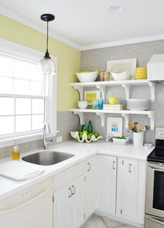 Lightening Up + Heading Out | Young House Love--like the 2 peninsula pendants and the other one over the sink! jb