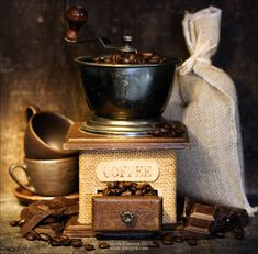 """Coffee Time"" Still life with Antique coffee grinder, burlap sack, coffee cups and chocolate on rustic table"