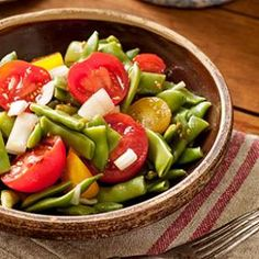 At first glance, you may think that vinegar or lemon juice has been inadvertently omitted from the ingredient list of this green bean and tomato salad recipe.