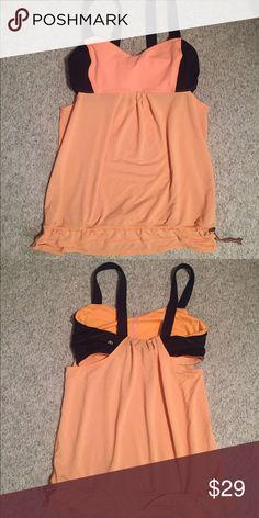 Lululemon workout top Orange and navy work out top with silver accents. Has built in bra, no padding present. Drawstring at the bottom to prevent top from slipping up (perfect for headstands👍🏾). Great condition with minimal wear. Tags removed. lululemon athletica Tops Tank Tops