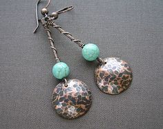 Beautiful one of a kind hammered and oxidized Copper swirl wire earrings with Green Marble fan drops and wire wrapped Olive Quartz beads. The total length is 2 inches from the top of the handmade swirl ear wire.  • 12 x 16 mm Green Marble fans • 20 gauge Copper wire • 4 mm Olive Quartz beads  I made these earrings with 20 gauge Copper Wire that I formed into the swirl ear wire shapes. Then I hammered to add texture and work harden the wire. I added wire wrapped Olive Quartz beads to the top…