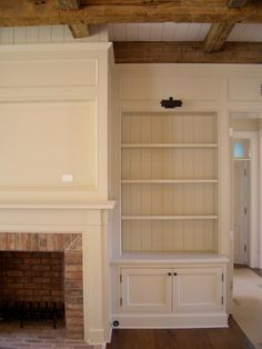 Always wanted a fireplace flanked by built in bookcases... wooden beams would just be a cherry on top.