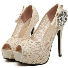 Delicate lace and rhinestone embellishment lend ladylike appeal to these peep toe pumps. Beige High Heels, Sexy High Heels, Rosa High Heels, Frauen In High Heels, High Heels Stilettos, Womens High Heels, Lace Pumps, Peep Toe Pumps, Cute Shoes