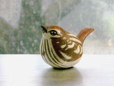 Ceramic Sparrow Sculpture on a rainy day