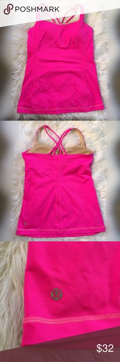 Hot pink lululemon workout top crisscross back Item: lululemon crisscross workout top Color: hot pink Size: 4 Condition: Preloved I great condition. Has bra inserts with padding included. No rips or holes. Color is too bright for my skin tone unfortunately. But very comfortable top!  No trades. lululemon athletica Tops