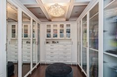 What a great ceiling and chandelier to have in a closet.  Organize it and you'll use it!  315 Essex, Kenilworth - contemporary - closet - chicago - by Heritage Luxury Builders