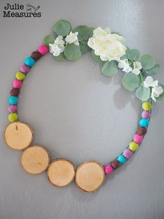 Create a Modern Hoop Wreath that lasts all year long! Learn how to make this large floral hoop wreath with wood slices and felt balls. Personalize it for every season! A beautiful and modern DIY hoop wreath. Floral Hoops, Felt Ball, Wood Slices, Balls, Swag, Beaded Necklace, Wreaths, Modern, How To Make