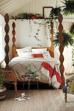 """Handcarved Ribbon Bed - anthropologie.com Handcarved mango wood. Natural finish. Posters are stacked octahedrons. 86""""H"""