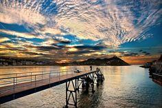 """Bahia de la Concha, San Sebastian - Donostia"" by Hercules Milas | Redbubble #Spain #Spanish #San #Sebastian #Donostia #Basque #Country #pais #Vasco #Bahia #playa #de #la #Concha #beach #beaches #town #towns #city #cities #gulf #bay #Cantabrian #sea #Monte #Iguelod #Atlantic #ocean #pier #piers #jetty #jetties #sunset #sunsets #gold #golden #hour #twilight #impressive #picturesque #spectacular #sky #skies #cloudx #cloudy #atmosphere #atmospheric #architecture #architectural #northern… Basque Country, Atlantic Ocean, Sunrises, Golden Hour, Travel Mug, Spain, Landscape, City, Beach"