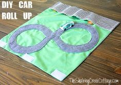 DIY Handmade Christmas Gifts for Boys: Car Roll Up --- I'm going to make this for my nephew, Caleb! Sewing For Kids, Baby Sewing, Free Sewing, Diy For Kids, Christmas Gifts For Boys, Handmade Christmas Gifts, Gifts For Kids, Diy Christmas, Sewing Hacks