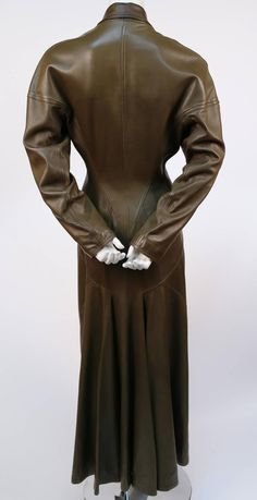 1980's AZZEDINE ALAIA olive leather full length coat | From a collection of rare vintage coats and outerwear at https://www.1stdibs.com/fashion/clothing/coats-outerwear/