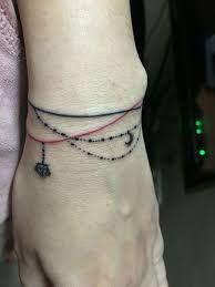 Resultado de imagem para charm bracelet tattoos for wrist