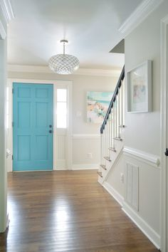 Neutral foyer edgecomb gray with blue front door